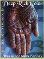 dark red henna color on palm of hand